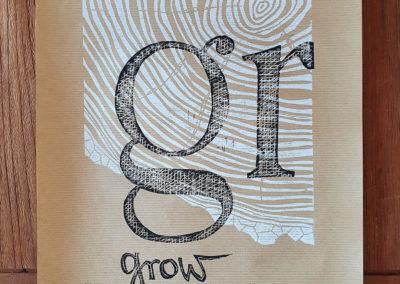 Signiert, limitiert, gestempelt: Motiv Grow mit Baumringen und Typografie